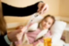 Nurse filling syringe for pediatric patient