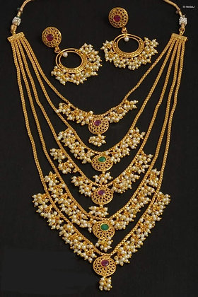 Multi layer gold toned necklace with pearls