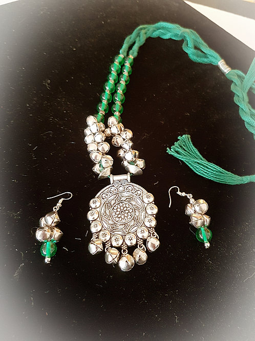 Green dori necklace set with silver pendant