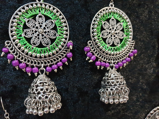 Green purple silver jumka earrings with thread work
