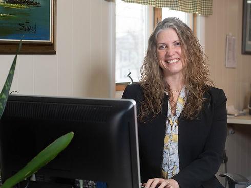 Goodnow Insurance employee at desk
