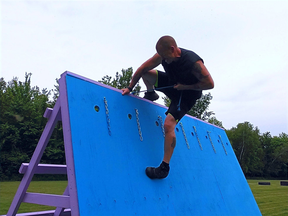 Josh King climbing Spartan obstacle wall