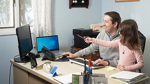 Mark Goodnow at desk with child