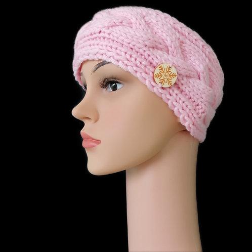 Modell Amy Stirnband Zopf handgestrickt magnolie