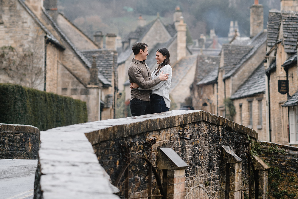 Engagement shoot in the rain ideas. Castle Combe Wiltshire. Wedding Photographer