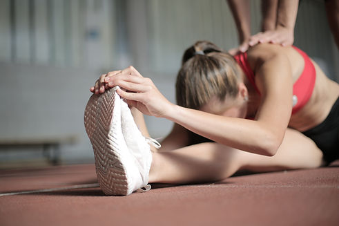photo-of-woman-stretching-3796796.jpg