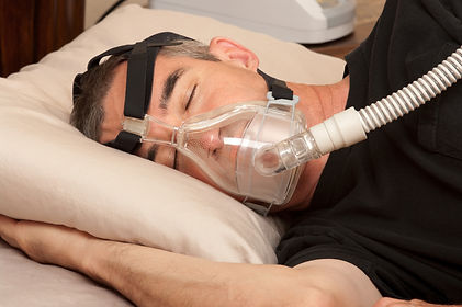 man asleep with cpap machine