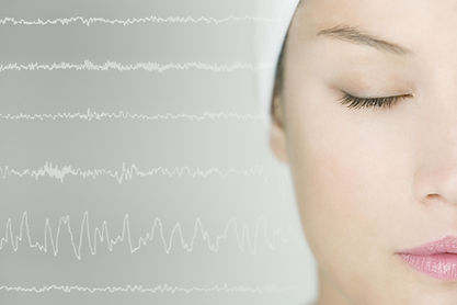 Woman sleeping with brain waves background