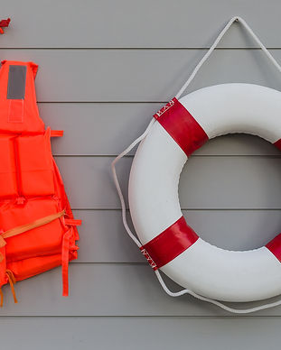 life vest and life belt on wooden wall.j