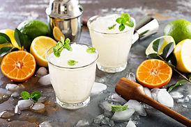 Refreshing summer alcoholic cocktail margarita with crushed ice and citrus fruits.jpg