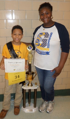 SCS Spelling Bee Winner Bradley Bolden with his awards, and with his teacher Rachel Helton