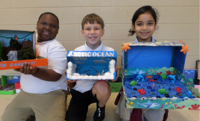 Grahamwood 2nd graders show off their habitat dioramas.