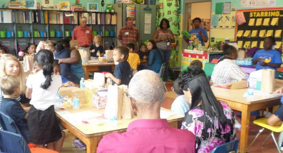 Ms. Helton's grandparents learn about their grandchildren's day at Grahamwood