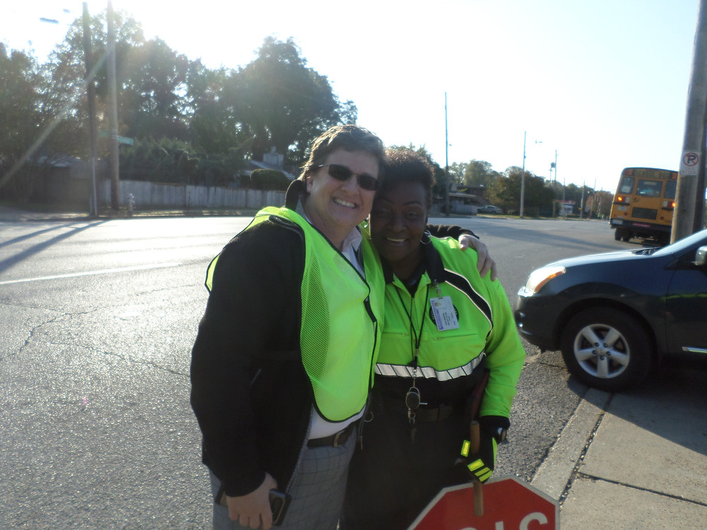 PTO President Laura Rogers congratulates Crossing Guard Ms. Flo (r) who is back on duty!