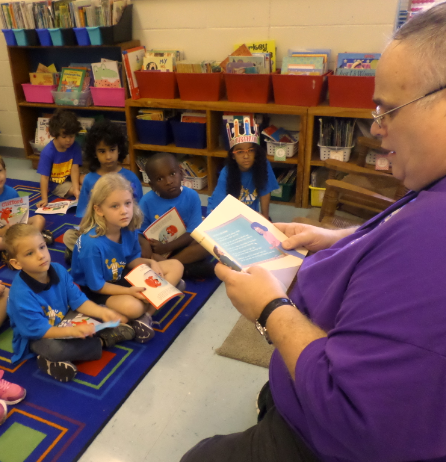 Crossing Guard Flo Wallace is honored for her service while FedEx and Safe Kids employees read to students.