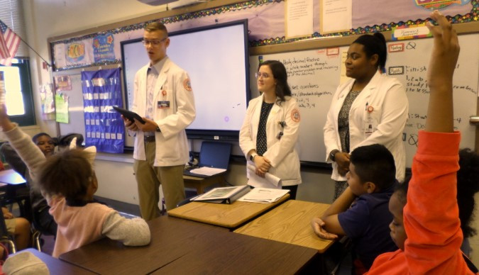 UTHSC Medical students discuss the dangers of tobacco with Grahamwood's students