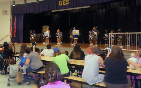 Grahamwood's Cheerleaders entertain the gathered crowd for ESL Night
