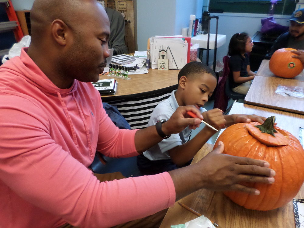 Dads and Grahamwood students bond over pumpkin carving and crafts