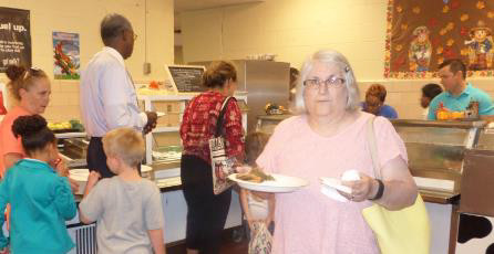 Grahamwood's Grandparents are served lunch by Principal Pete Johnson & Assistant Principal Tia James