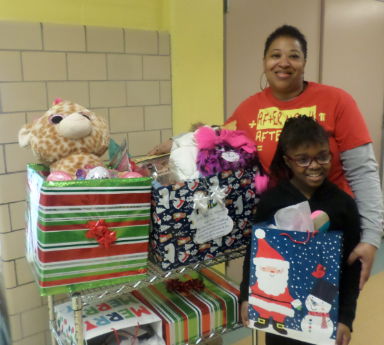 Savannah with Ms. McKinney show off the Christmas surprise!