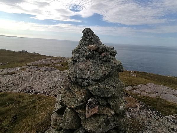 walk 3rd cairn over sea.jpg