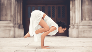 yoga pose on ancient building