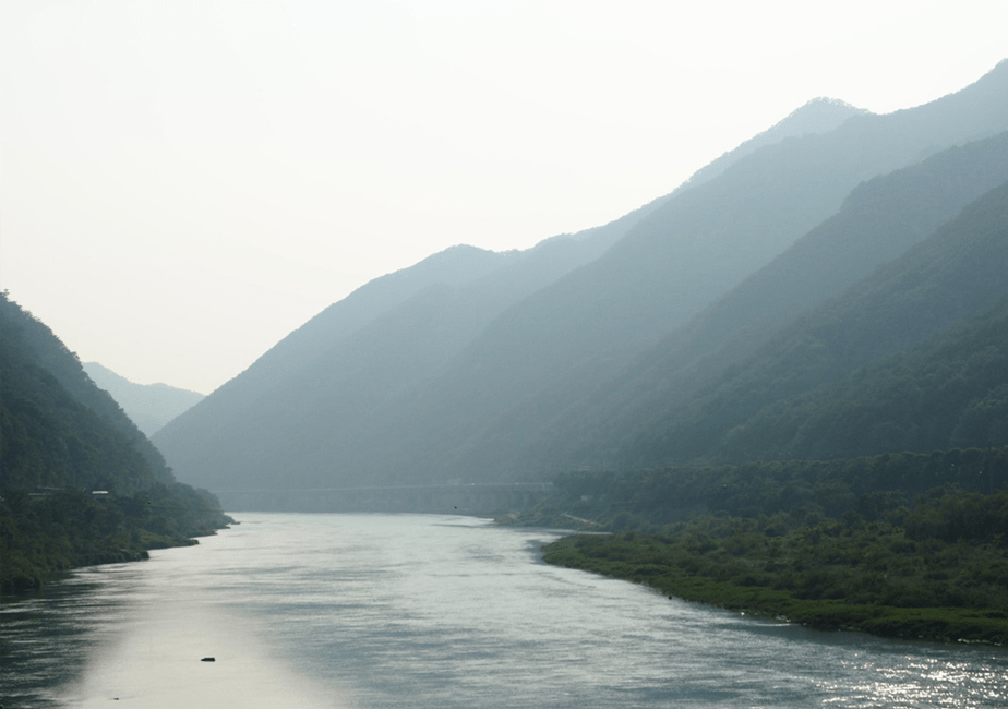 misty green mountains and blue river