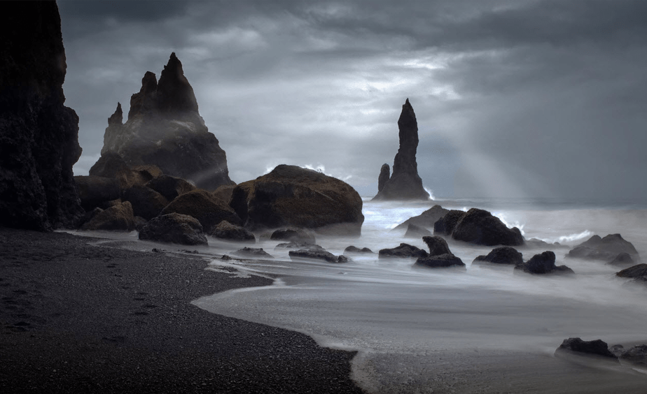 storm sky and sunlight on a moody rocky beach