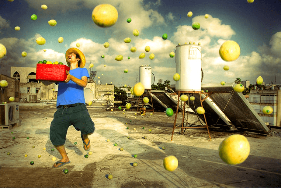 Surreal photo of a man collecting lemons falling from the sky