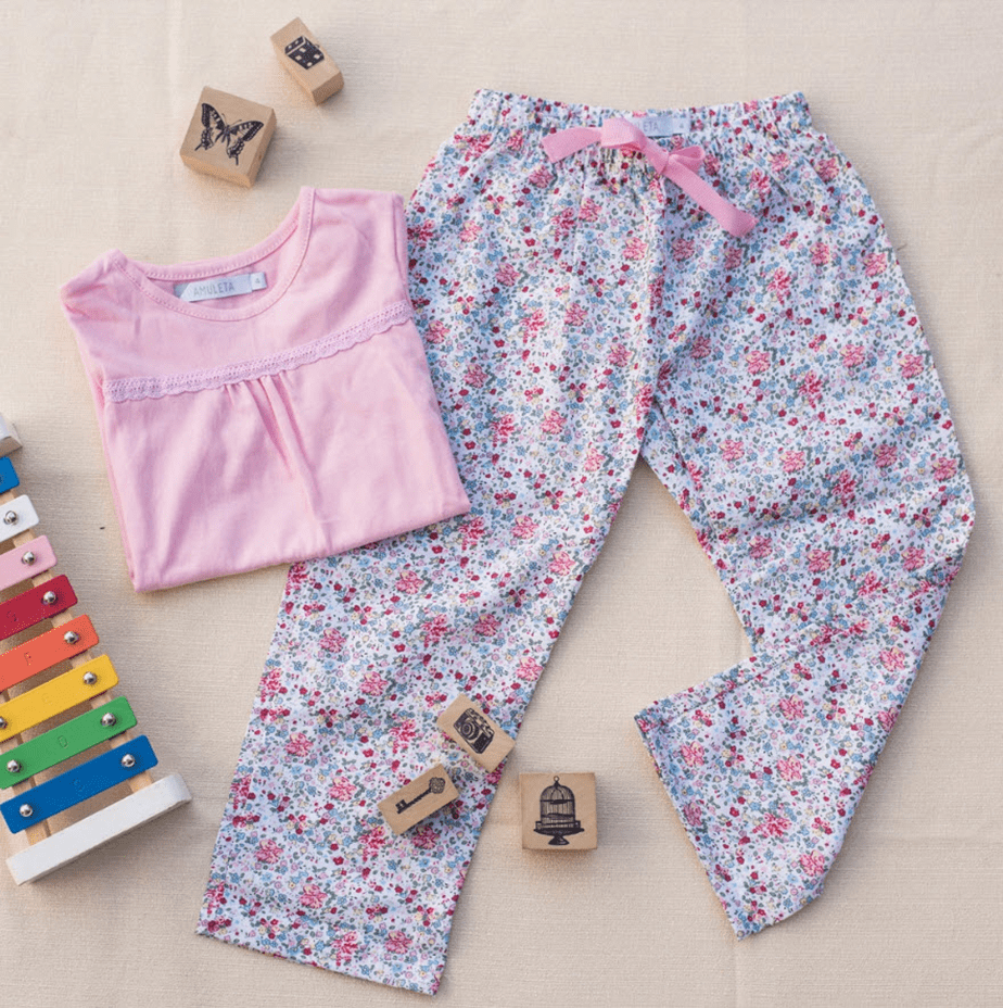 flower pattern pants and pink shit with toys