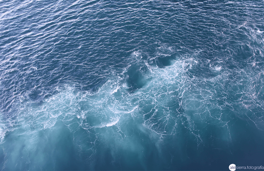 overview of the blue sea as the waves meet