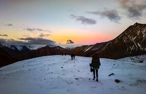 mountain sunrise with snowed peak