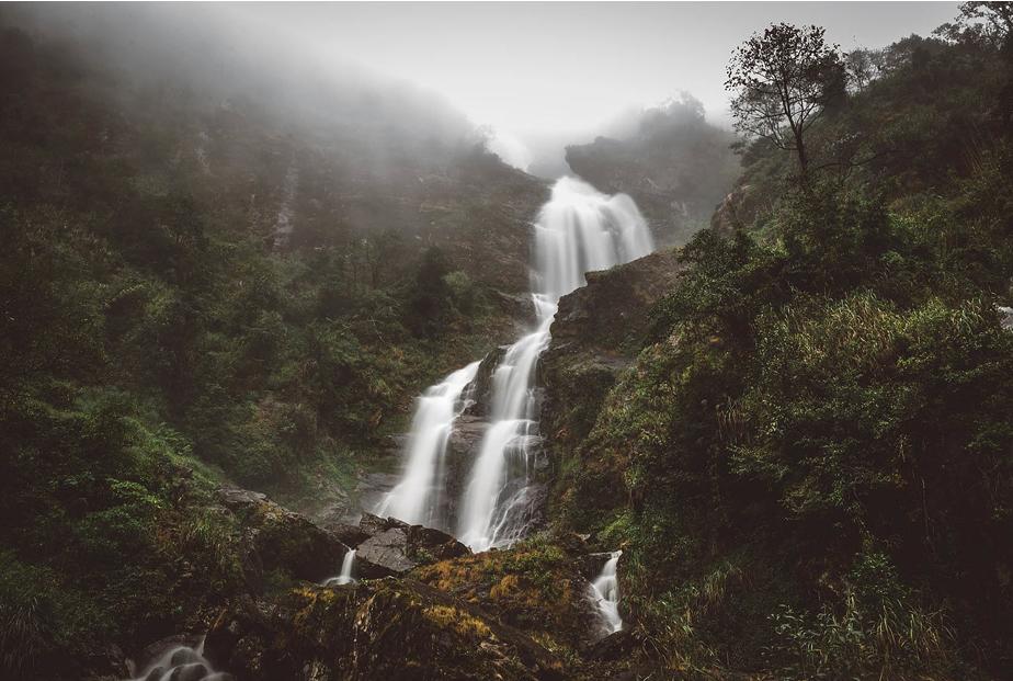 waterfall in foggy mountain