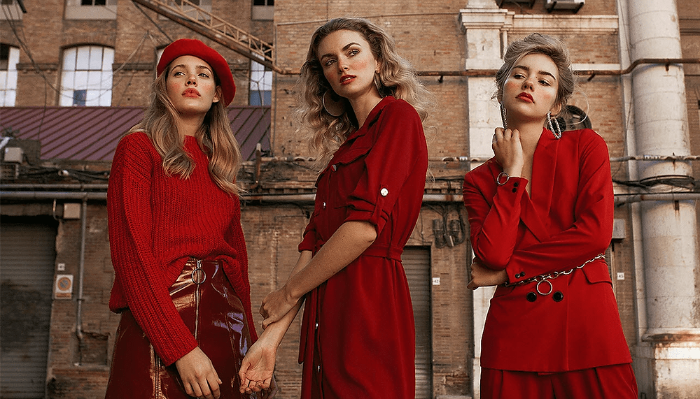 fashion portrait of three women in red clothing
