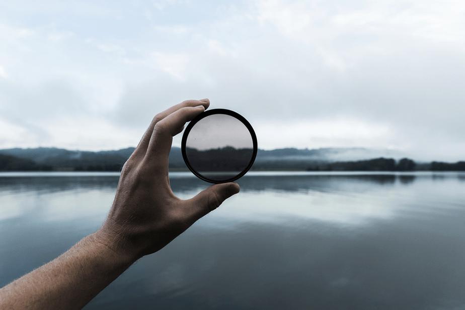 neutral density filter held in front of a landscape