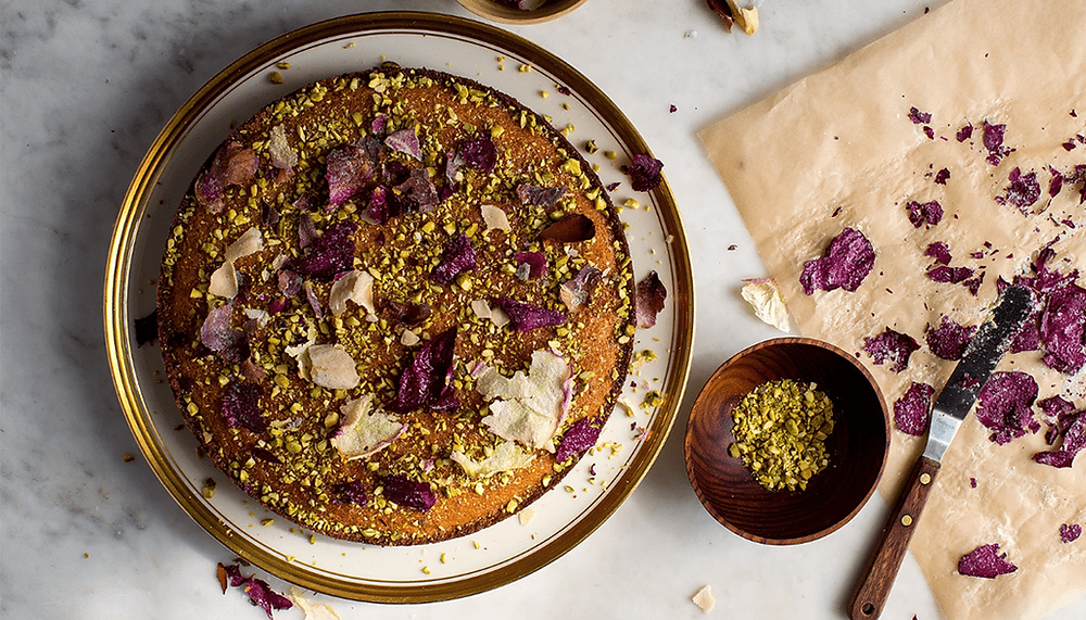 top view of a cake covered with nuts and dried flowers