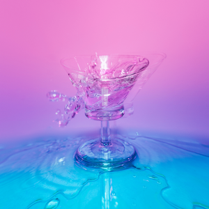 pink and blue glass cup splashed with liquid
