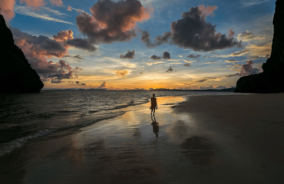 woman on the beach in sunset