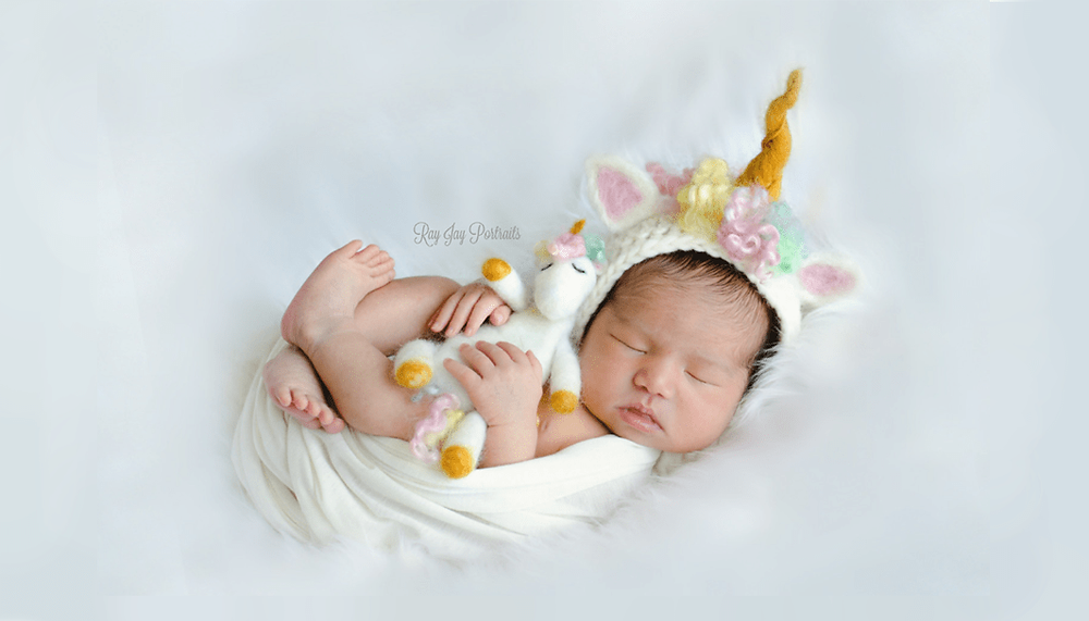 baby dressed as a unicorn