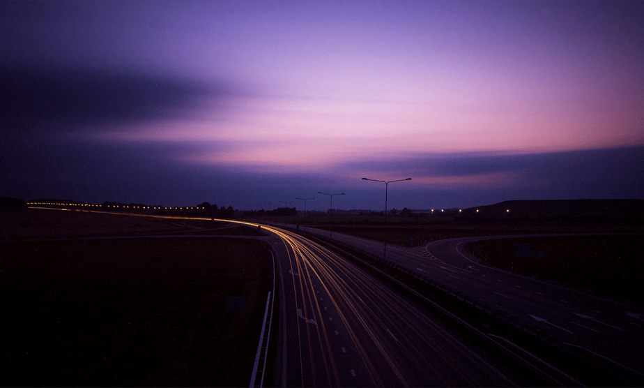 car long exposure light trails on sunset