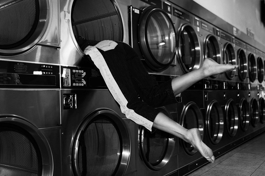 legs of a woman in a laundry machine by wix photographer Jhana