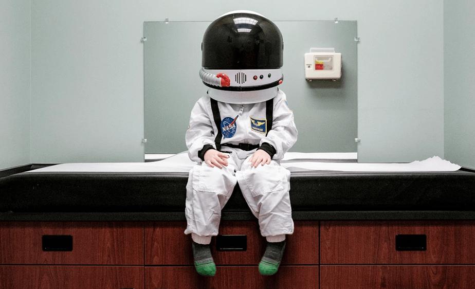 little boy dressed as an astronaut