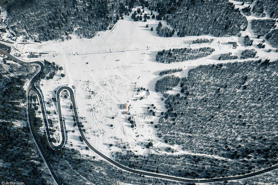 snowed sky resort and forest aerial view