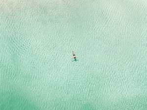 person on the sea aerial view