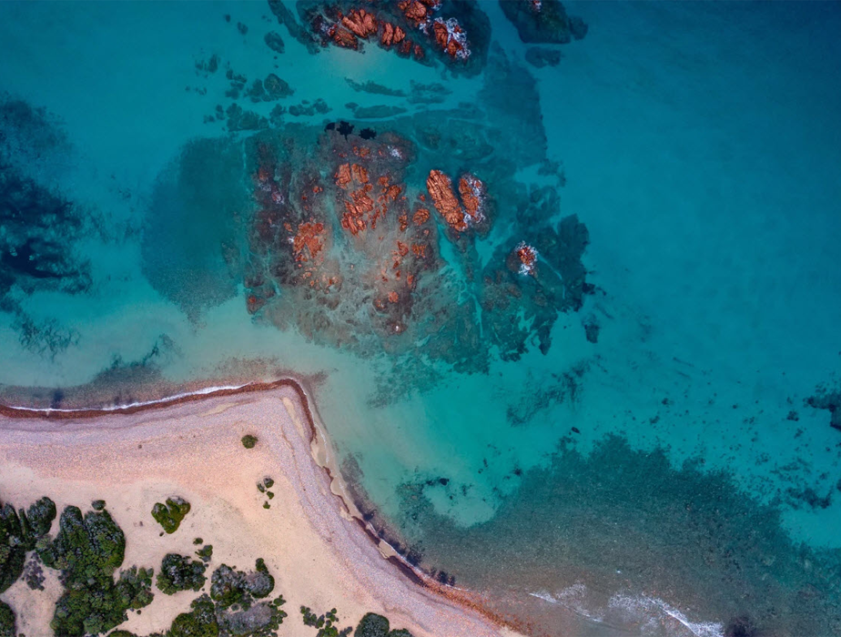 drone view of beach and little island