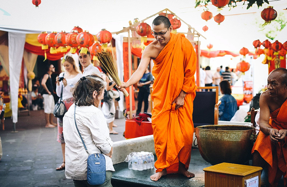 woman is blessed by monk
