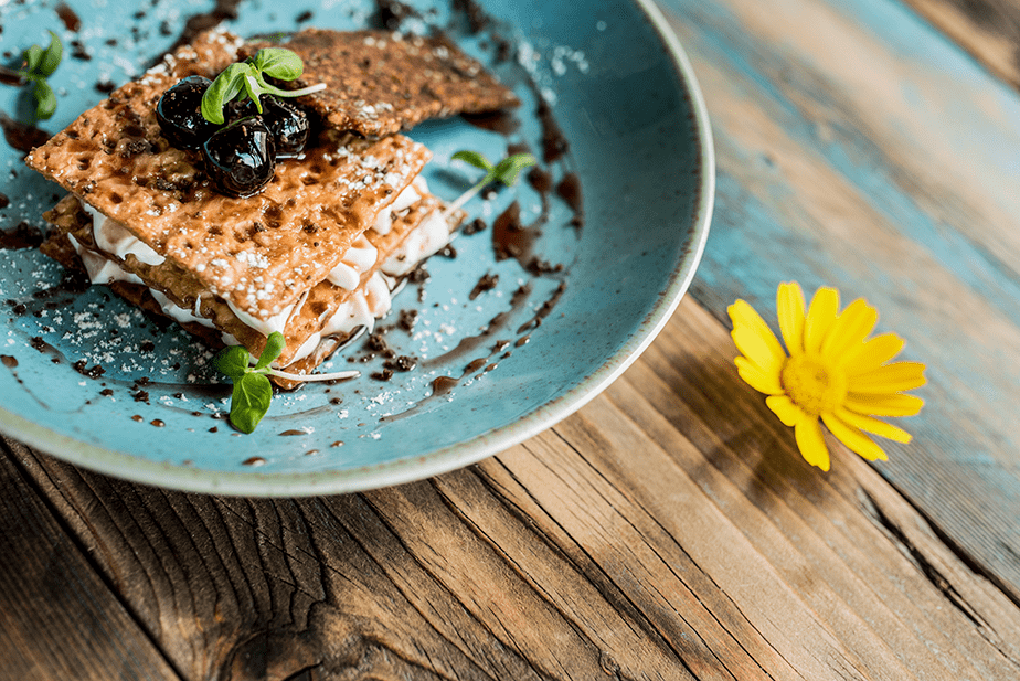 food served on blue plate over wooden table