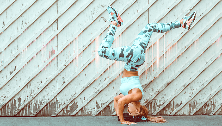 yoga pose on urban wall