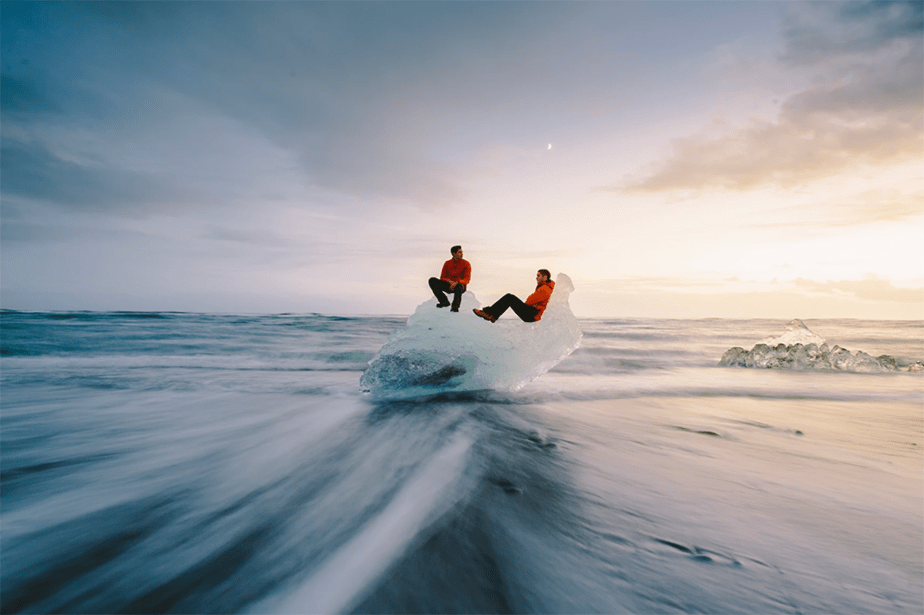 two people on a big chunk of ice