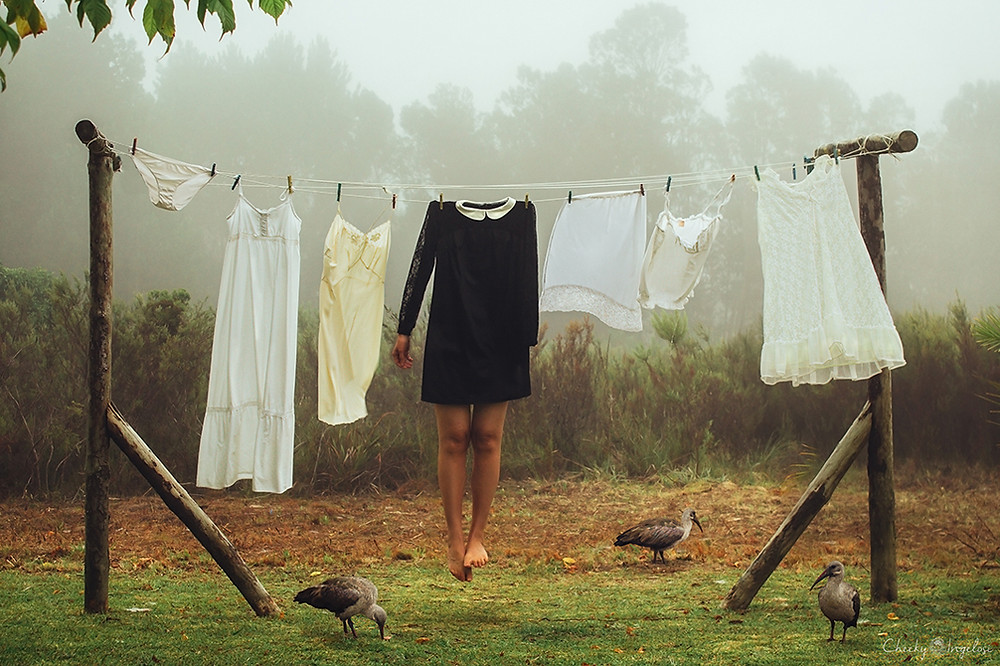 personal photography project on depression - clothes hanging on a wire with headless woman